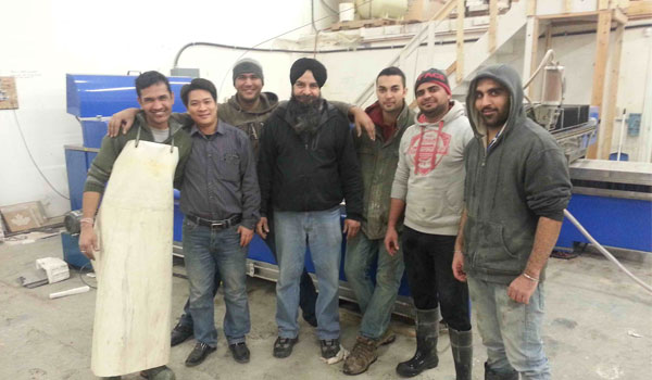 Group photo of Canadian customers and SAME technicians 600*350
