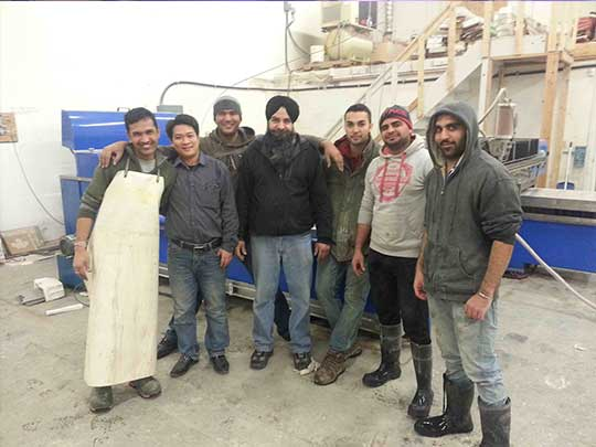 Group photo of Canadian customers and SAME technicians 540*405