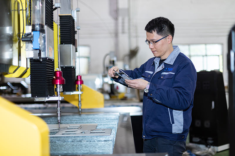 SAME waterjet technicians are testing accuracy